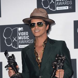 Bruno Mars will be taking to the stage at the Brits