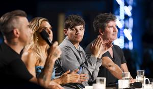 Tomlinson appeared as a judge on X Factor (Tom Dymond/Syco/Thames TV/PA)
