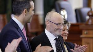 Phil Collins is applauded after becoming an honorary Texan