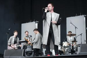 Everything Everything perform live on stage (David Jensen/PA)