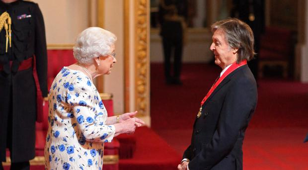 Sir Paul McCartney was made a Companion of Honour by the Queen during an investiture ceremony at Buckingham Palace (Yui Mok/PA)