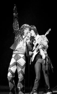 Mick Jagger and Ronnie Wood (right) seen together in a picture from 1976, in harmony on stage at the Apollo Theatre in Glasgow, where the Rolling Stones were taking the town by storm.