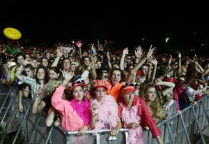 The crowd watching Foals performing on the Main Stage at Bestival, held at Robin Hill Adventure Park, Isle of Wight.