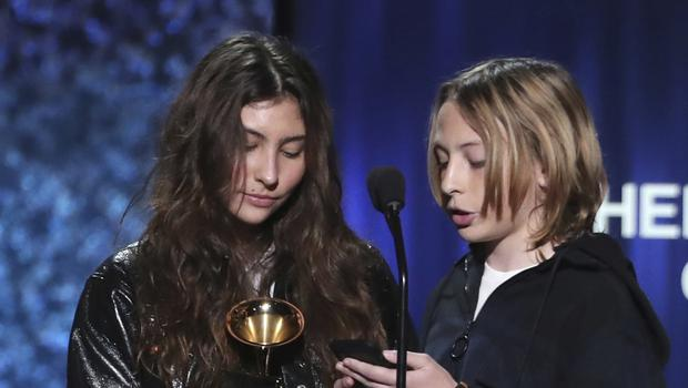 Toni Cornell, left, and Christopher Nicholas Cornell accept the award for best rock performance for When Bad Does Good on behalf of their late father Chris Cornell (Matt Sayles/Invision/AP)
