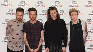 Liam Payne, Louis Tomlinson, Harry Styles and Niall Horan of One Direction (Joe Giddens/PA)