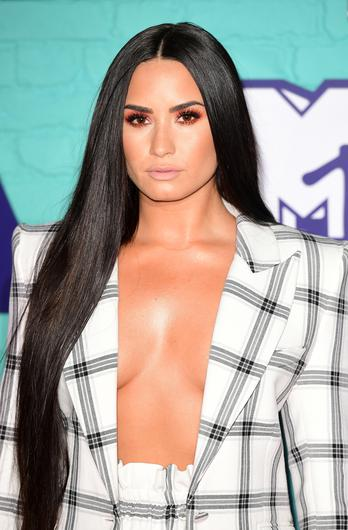 Demi Lovato's mother has said the star is recovering well after she was taken to hospital (Ian West/PA Wire)