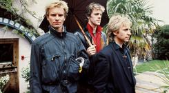 Sting, Stewart Copeland and Andy Summers of The Police in 1983 (PA)
