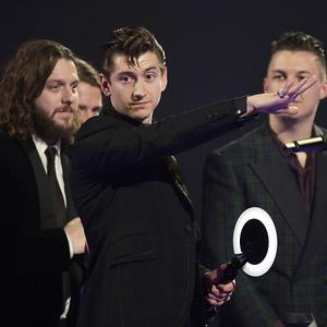 Alex Turner of the Arctic Monkeys on stage after winning Best British Group during the 2014 Brit Awards at the O2 Arena, London.