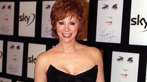 American country singer Reba McEntire has paid tribute to her mother (Peter Jordan/PA)