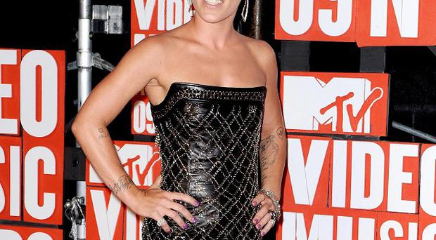 Pink says she doesn't aspire to look conventional