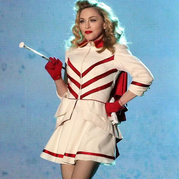 Madonna is planning to sell some of her MDNA world tour costumes for charity