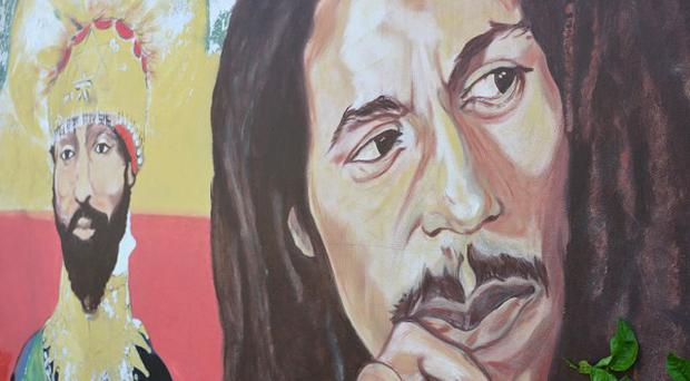 A mural depicting reggae music icon Bob Marley at his Kingston home, in Jamaica (AP)
