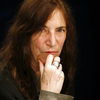 FILE - This May 29, 2012 file photo shows rock musician and writer Patti Smith in New York. Smith is being honored by Bryn Mawr College with a medal named after the late actress Katharine Hepburn. Smith accepted the 2013 Katharine Hepburn Medal on Thursday night, Feb. 7, 2013 in a ceremony at the college in suburban Philadelphia. (AP Photo/John Carucci, File)