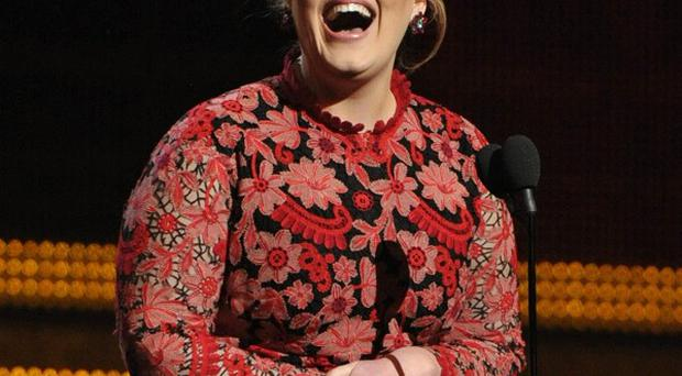 Adele says she is out of the loop when it comes to making music