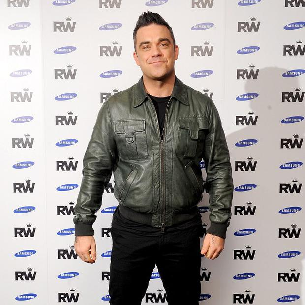 Robbie Williams has been working with Guy Chambers again