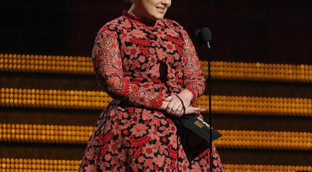 Adele didn't seem impressed by Chris Brown's behaviour at the Grammys ceremony