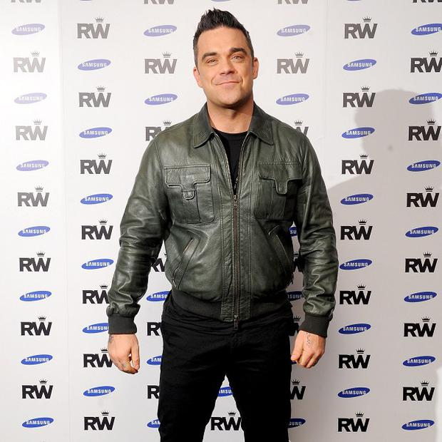 Robbie Williams thinks Justin Bieber might feel the pressures of fame