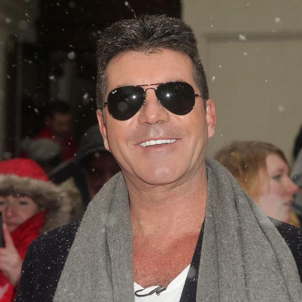 Simon Cowell will turn out to be an alien in a new musical