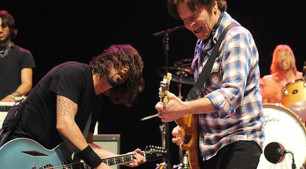 Dave Grohl and John Fogerty perform on stage at the Sound City Players concert in New York