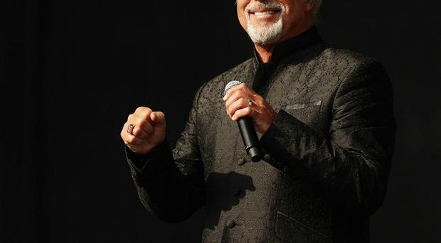 Sir Tom Jones performing on The Virgin Media Stage at the V Festival in Hylands Park, Chelmsford. PRESS ASSOCIATION Photo. Picture date: Sunday August 19, 2012. See PA story SHOWBIZ VFestival. Photo credit should read: Yui Mok/PA Wire