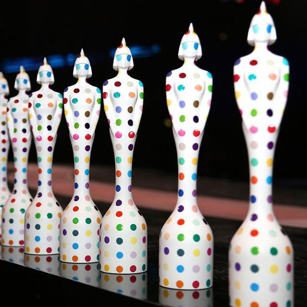 Brit Awards statues designed by Damien Hirst line up on the stage at The O2 in London