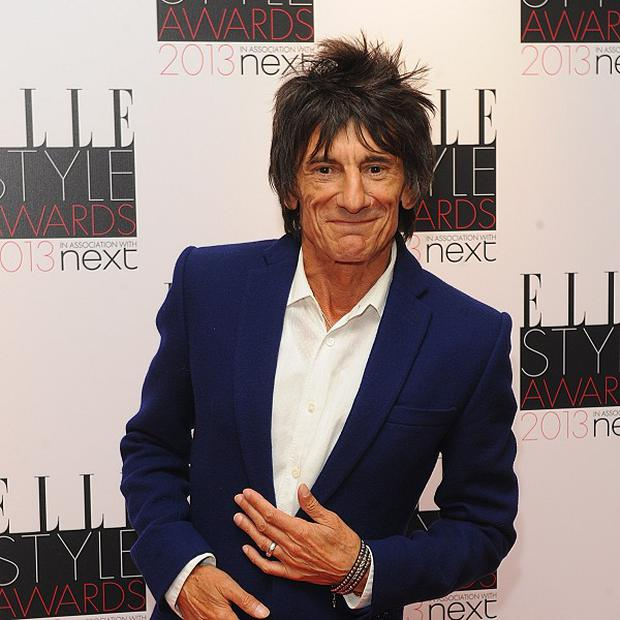 Ronnie Wood gave secondary school students some guitar tips