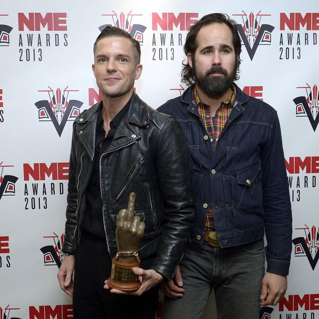 Brandon Flowers (left) and Ronnie Vannucci Jr of The Killers with the award for Best International Band at the NME awards held at the Troxy, London. PRESS ASSOCIATION Photo. Picture date: Wednesday February 27, 2013. Photo credit should read: Jonathan Brady/PA Wire