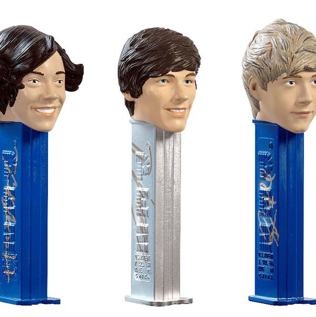 One-off Pez dispensers of boy band One Direction are to be auctioned off to raise money for Comic Relief