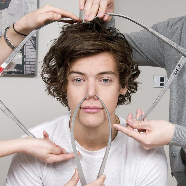 Harry Styles from One Direction is measured up for his waxwork