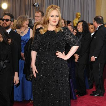 Adele is apparently considering splitting her time between America and the UK