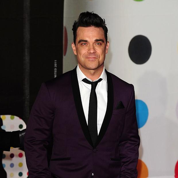 Robbie Williams has had a rant about Brett Anderson's comments