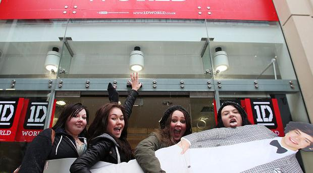 Four fans outside the new 1D World pop-up story in Leeds