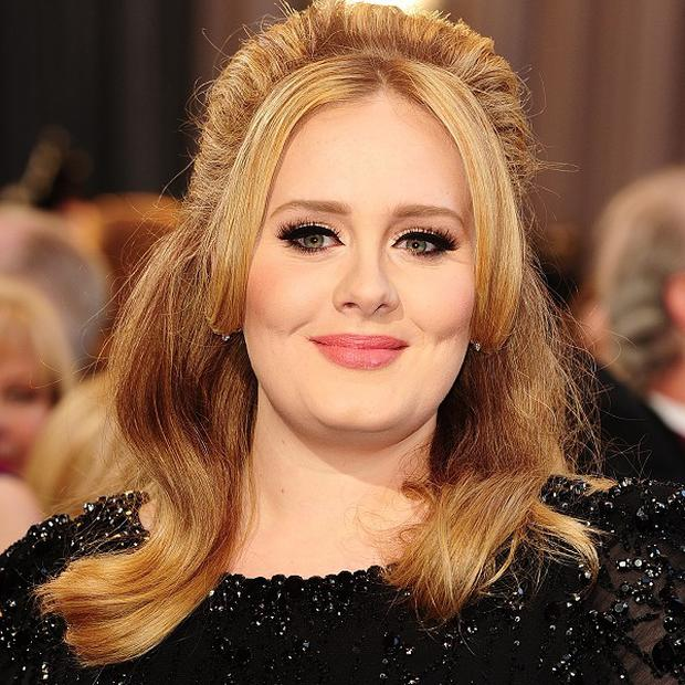 Adele could be teaming up with Robbie Williams