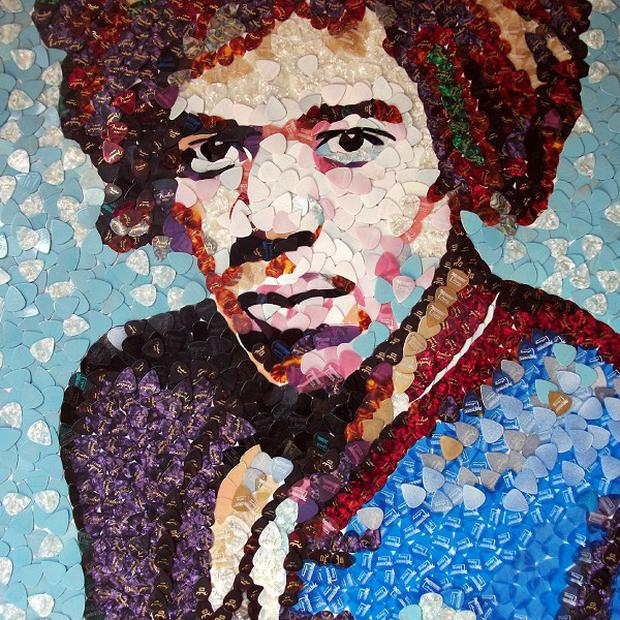 A mosaic of guitar legend Jimi Hendrix has been made by Ed Chapman out of thousands of Fender plectrums (Ed Chapman/PA)