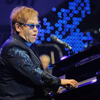 Sir Elton John and his songwriting partner will be honoured by the Hall of Fame