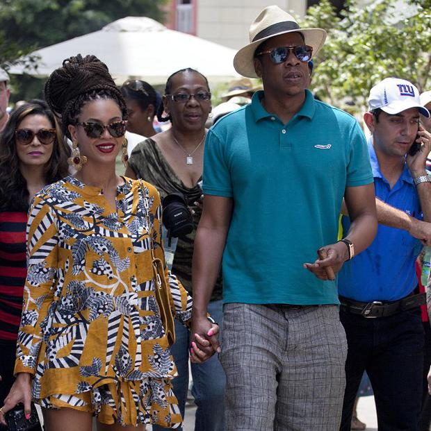 Beyonce and her husband Jay-Z hold hands as they tour Old Havana, Cuba