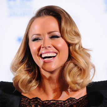 Former Girls Aloud star Kimberley Walsh has signed a deal to write her autobiography