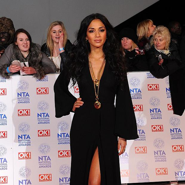 Nicole Scherzinger is apparently worried about juggling her singing commitments with The X Factor