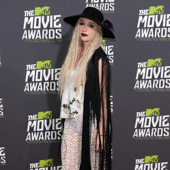 Kesha said her mum is proud of her daring style choices