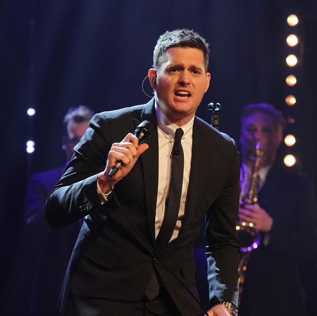Michael Buble's latest album sold 121,000 copies in its opening week