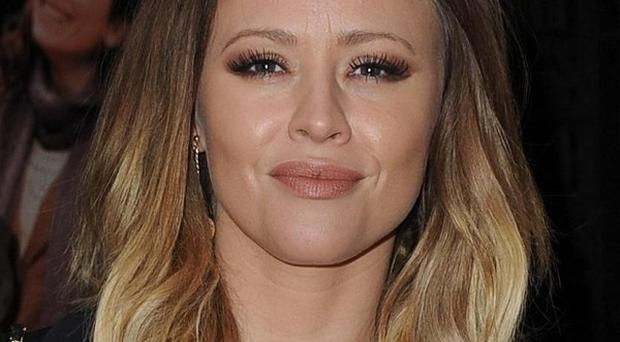 Kimberley Walsh has promised fireworks in her new book