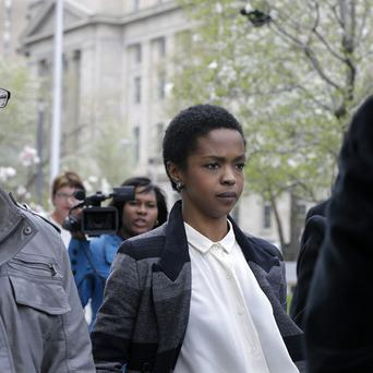 Lauryn Hill leaving court after a hearing regarding her tax evasion charges