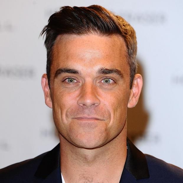 Robbie Williams has been working with Dizzee Rascal