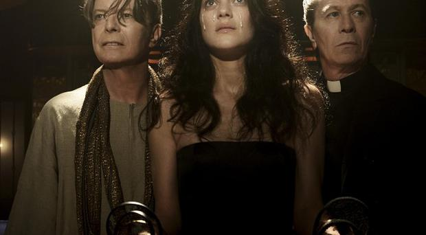 Marion Cotillard and Gary Oldman appear in David Bowie's new video