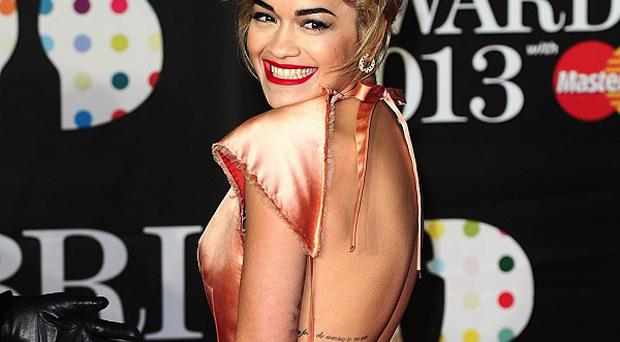 Rita Ora is thought to be dating Calvin Harris