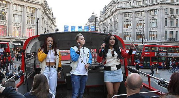 Stooshe performed their new songs from the top of a bus