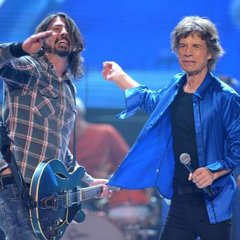 Dave Grohl took to the stage with Mick Jagger