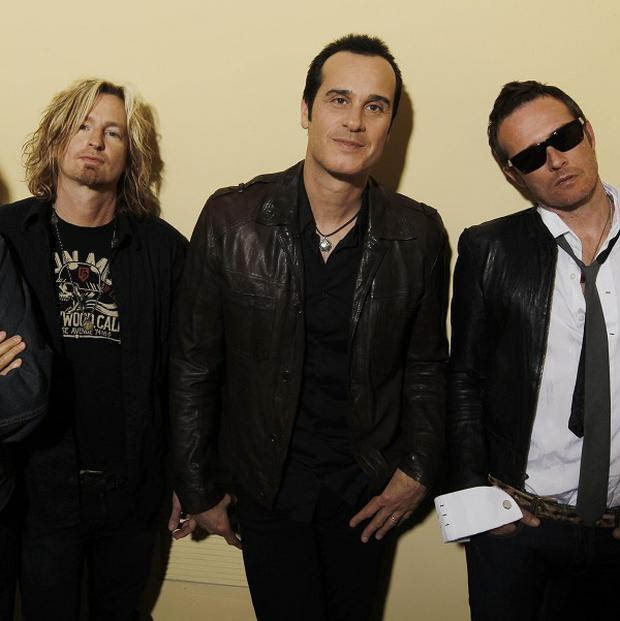 Stone Temple Pilots, from left, Dean Deleo, Eric Kretz, Robert Deleo, and Scott Weiland (AP/Matt Sayles)