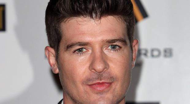 Robin Thicke has hit the top of the charts for the first time in the UK