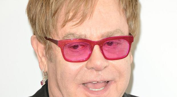 Sir Elton John said he was excited to play on a rock record